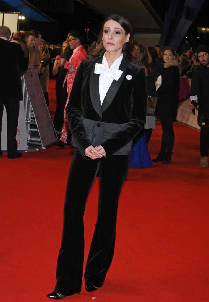 <p>Suranne Jones went high fashion for the red carpet at this year's ceremony, as she chose a velvet suit (complete with oversized bow) by Giles Deacon. The actress finished the look with a pair of Christian Louboutin heels. <em>[Photo: Getty]</em> </p>
