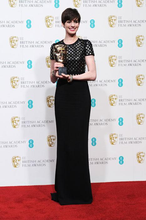 Anne Hathaway poses with her Best Supporting Actress Award in the press room at The EE British Academy Film Awards 2013 at The Royal Opera House on February 10, 2013 in London, England. (Photo by Dave J Hogan/Getty Images)