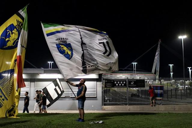 Fans celebrating outside the Allianz Stadium after Juventus won a ninth Serie A title in a row. (AFP Photo/MARCO BERTORELLO)
