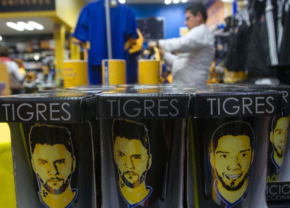At the official team stores, cups, T-shirts and notebooks with Gignac's image were sold out. His team jersey is also a popular item. AFP PHOTO / JULIO CESAR AGUILAR (AFP Photo/JULICO CESAR AGULAR)