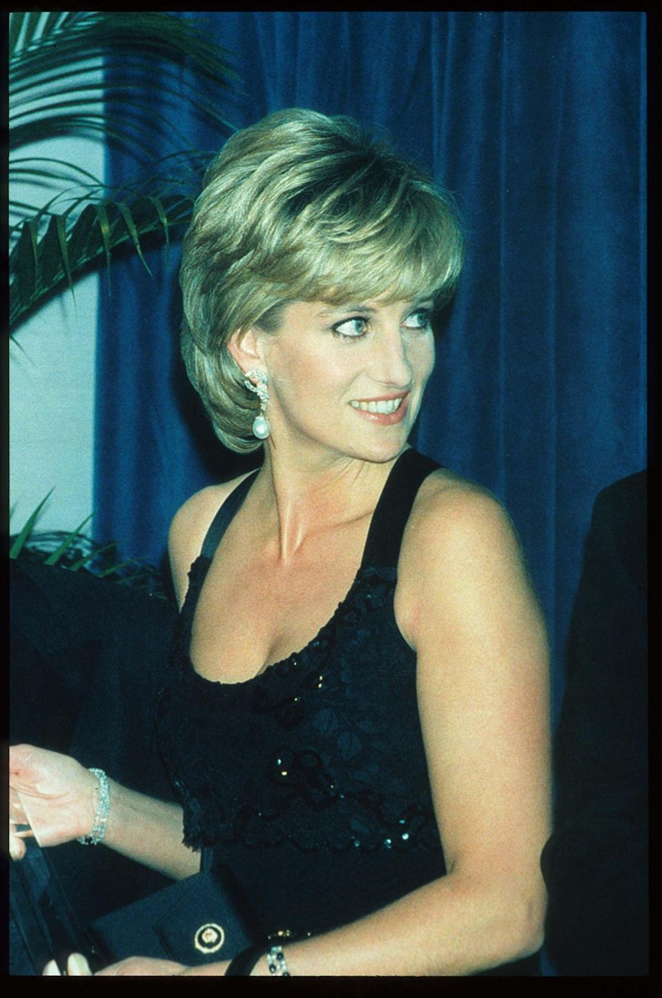 <p>On glamorous evenings, Princess Diana added extra volume to her layered bob.</p>