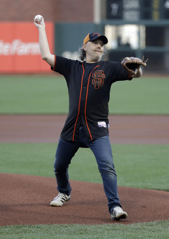 Metallica's Lars Ulrich throws the ceremonial first pitch before a baseball game between the San Francisco Giants and the Washington Nationals Monday, April 23, 2018, in San Francisco. (AP Photo/Marcio Jose Sanchez)