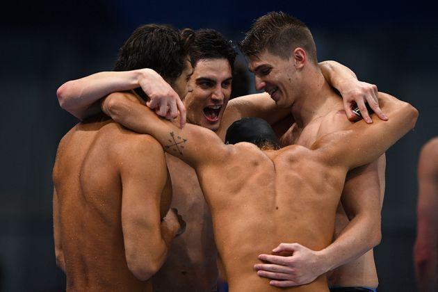 Silver medallists Italy's Alessandro Miressi, Italy's Thomas Ceccon, Italy's Lorenzo Zazzeri and Italy's Manuel Frigo celebrate winning the silver medal in the final of the men's 4x100m freestyle relay swimming event during the Tokyo 2020 Olympic Games at the Tokyo Aquatics Centre in Tokyo on July 26, 2021. (Photo by Oli SCARFF / AFP) (Photo by OLI SCARFF/AFP via Getty Images) (Photo: OLI SCARFF via Getty Images)