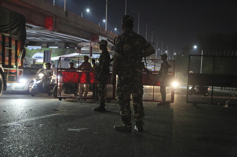 Indian paramilitary soldiers stand guard near a checkpost in Jammu, India, Thursday, Aug. 8, 2019. Indian Prime Minister Narendra Modi says a federally-ruled Indian portion of Kashmir will help end decades-old separatism incited by archrival Pakistan. Describing changes in Kashmir as historic, Modi assures Kashmiri people that the situation in the region will soon become normal. (AP Photo/Channi Anand)