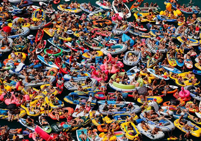 <p>People on inflatable boats enjoy the weather on the Lake Lucerne in Sisikon, Switzerland, Aug. 5, 2018. (Photo: Denis Balibouse/Reuters) </p>
