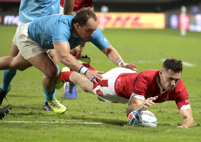 Wales' Tomos Williams scores a try during the Rugby World Cup Pool D game at Kumamoto Stadium between Wales and Uruguay in Kumamoto, Japan, Sunday, Oct. 13, 2019. (AP Photo/Aaron Favila)