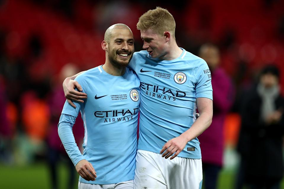 Spain's David Silva, left, and Belgium's Kevin de Bruyne are just two of the internationals heading to Russia from Manchester City's stacked squad. (Getty)