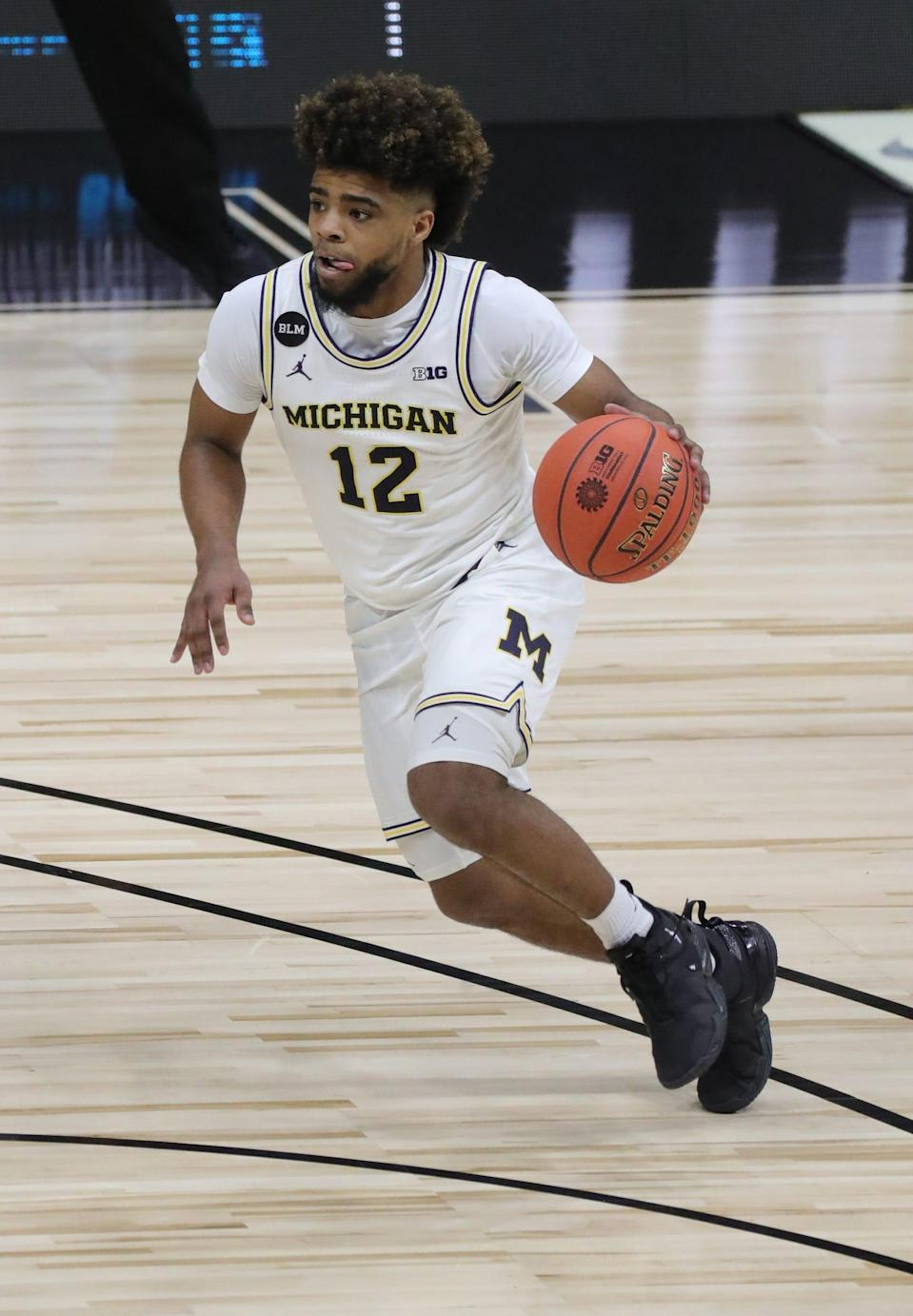 Michigan guard Mike Smith drives against Maryland during Wolverines' 79-66 win in the Big Ten tournament quarterfinals Friday, March 12, 2021 at Lucas Oil Stadium in Indianapolis.