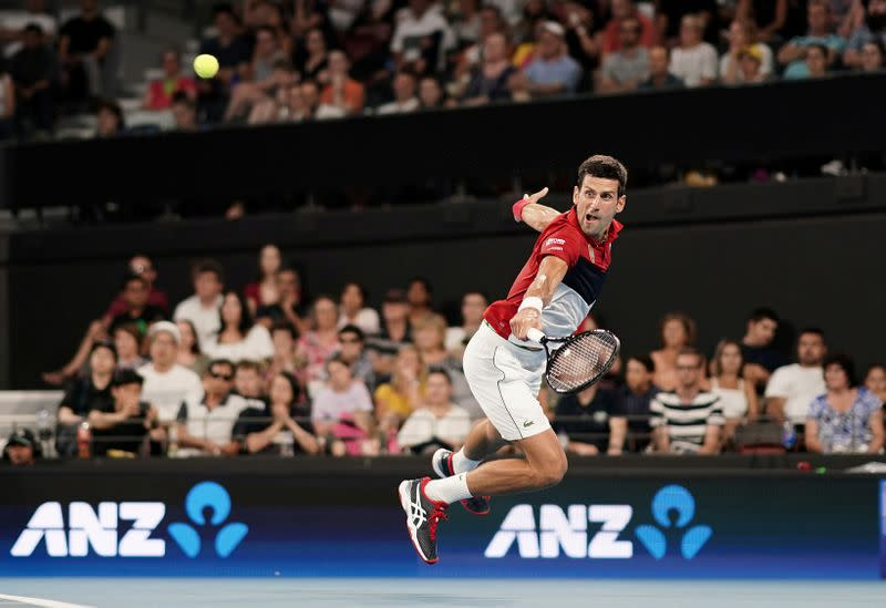 Novak Djokovic of Serbia returns during his singles match against Kevin Anderson of South Africa on day 2 of the ATP Cup tennis tournament at Pat Rafter Arena in Brisbane