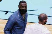 Los Angeles Lakers' LeBron James looks up to the fans during the second half of an NBA basketball game against the Miami Heat, Thursday, April 8, 2021, in Miami. (AP Photo/Marta Lavandier)