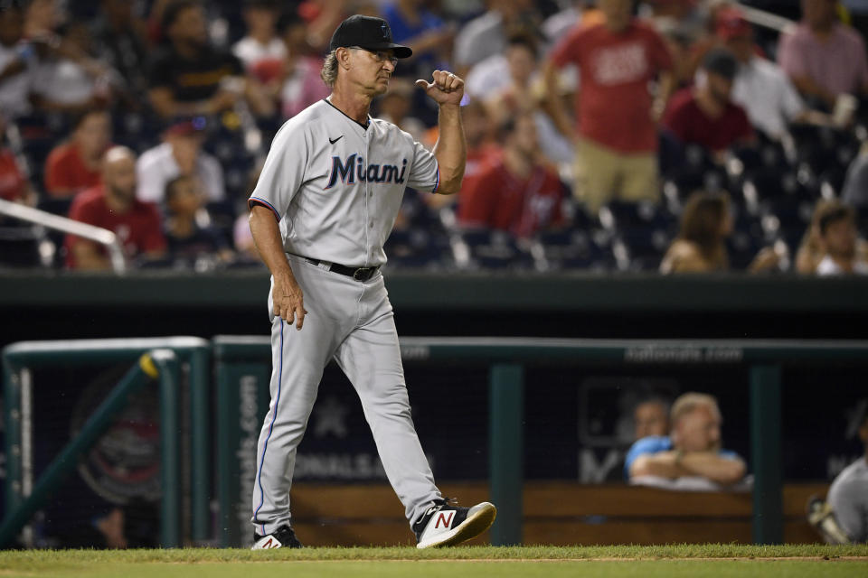 Miami Marlins manager Don Mattingly walks to the mound for a pitching change during the seventh inning of a baseball game against the Washington Nationals, Monday, July 19, 2021, in Washington. (AP Photo/Nick Wass)