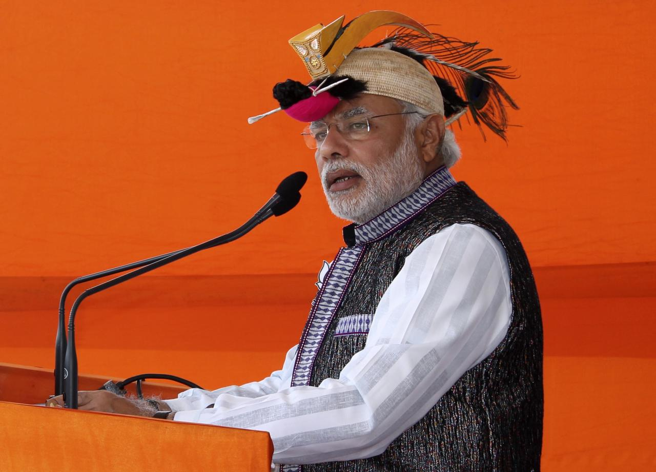 Hindu nationalist Narendra Modi, prime ministerial candidate for main opposition Bharatiya Janata Party (BJP) and Gujarat's chief minister, addresses his supporters during a rally ahead of the general election in Itanagar in the northeastern Indian state of Arunachal Pradesh March 31, 2014. India, the world's largest democracy, will hold its general election in nine stages staggered between April 7 and May 12. REUTERS/Stringer (INDIA - Tags: POLITICS ELECTIONS)
