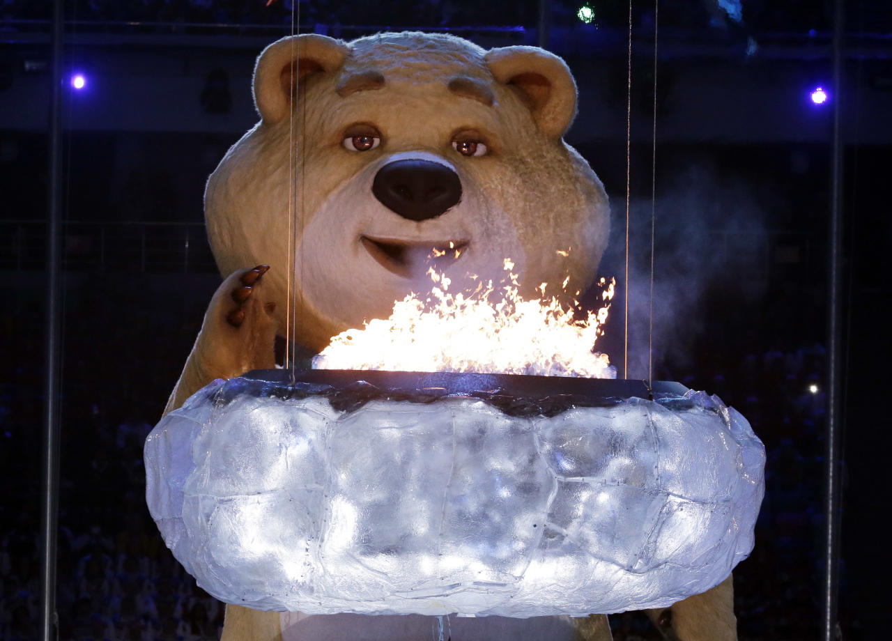 A large mascot blows out the Olympic flame with his breath during the closing ceremony of the 2014 Winter Olympics, Sunday, Feb. 23, 2014, in Sochi, Russia. (AP Photo/Charlie Riedel)
