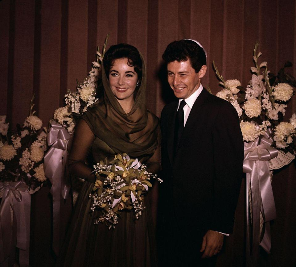 """<p>Elizabeth Taylor was still coping with the death of her third husband, Mike Todd, when she found herself in the arms of actor <a href=""""http://abcnews.go.com/Entertainment/marriages-liz-taylor/story?id=13202596"""" rel=""""nofollow noopener"""" target=""""_blank"""" data-ylk=""""slk:Eddie Fisher"""" class=""""link rapid-noclick-resp"""">Eddie Fisher</a>, who was married at the time to her longtime friend Debbie Reynolds. Taylor and Fisher married in 1959 and divorced in 1964. </p>"""