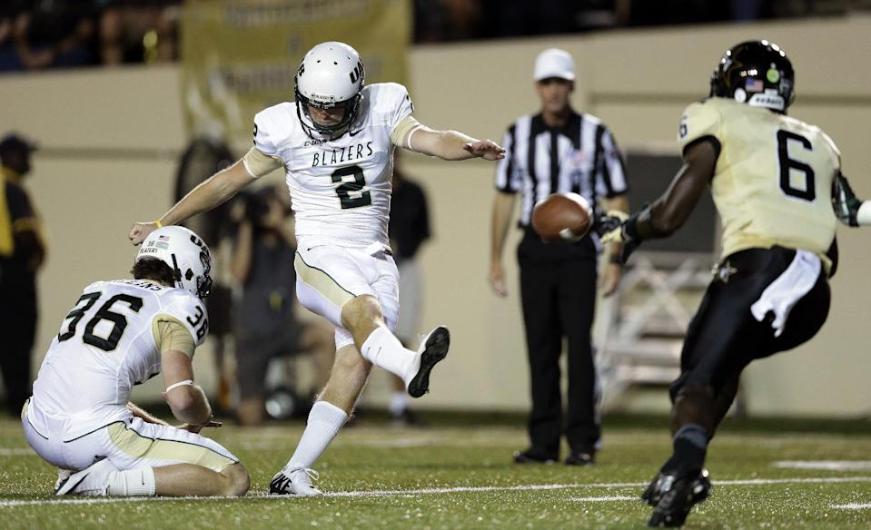 UAB kicker Ty Long (2) kicks a 20-yard field goal as Vanderbilt defensive back Darrius Sims (6) rushes in the second quarter of an NCAA college football game on Saturday, Sept. 28, 2013, in Nashville, Tenn. UAB's Hunter Mullins (36) holds for Long. (AP Photo/Mark Humphrey)