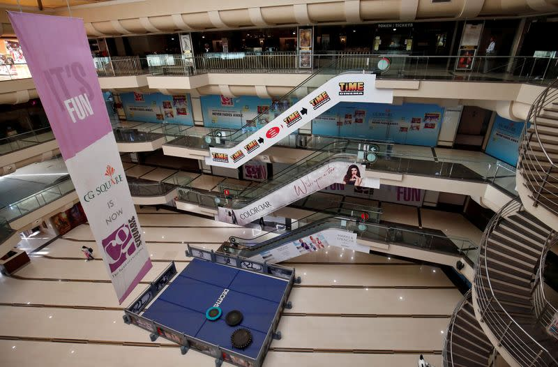 FILE PHOTO: A view of an empty shopping mall is seen after Gujarat state government banned public gatherings to avoid the spreading of the coronavirus, in Ahmedabad