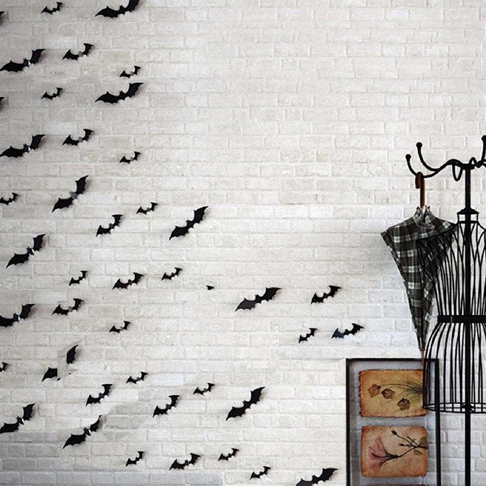<p>Place these <span>HOZZQ Scary Bats Wall Decal Stickers</span> ($10) onto a window or any smooth surface. These come in packs of 28, so you can get as batty as you'd like!</p>
