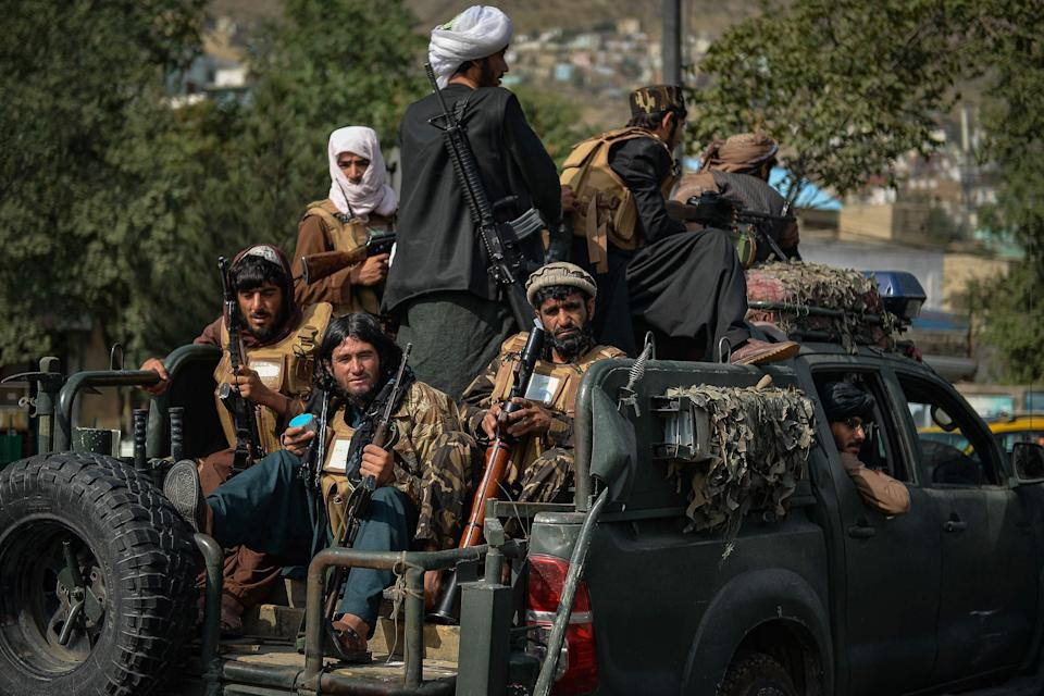 Taliban fighters patrol along a street in Kabul earlier today (AFP via Getty Images)