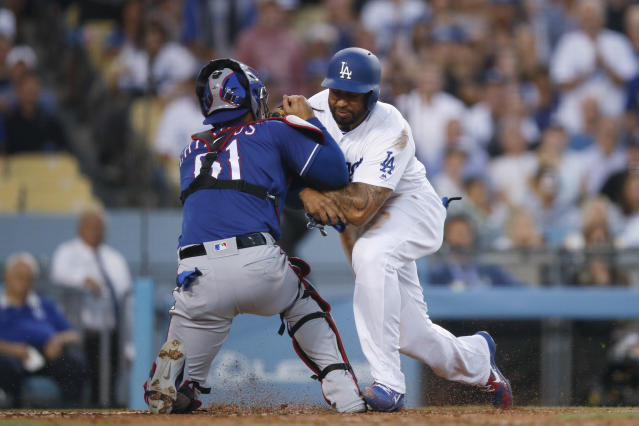 Matt Kemp barreled over Rangers C Robinson Chirinos during a play at the plate Wednesday, prompting both benches to empty at Dodgers stadium. (AP)