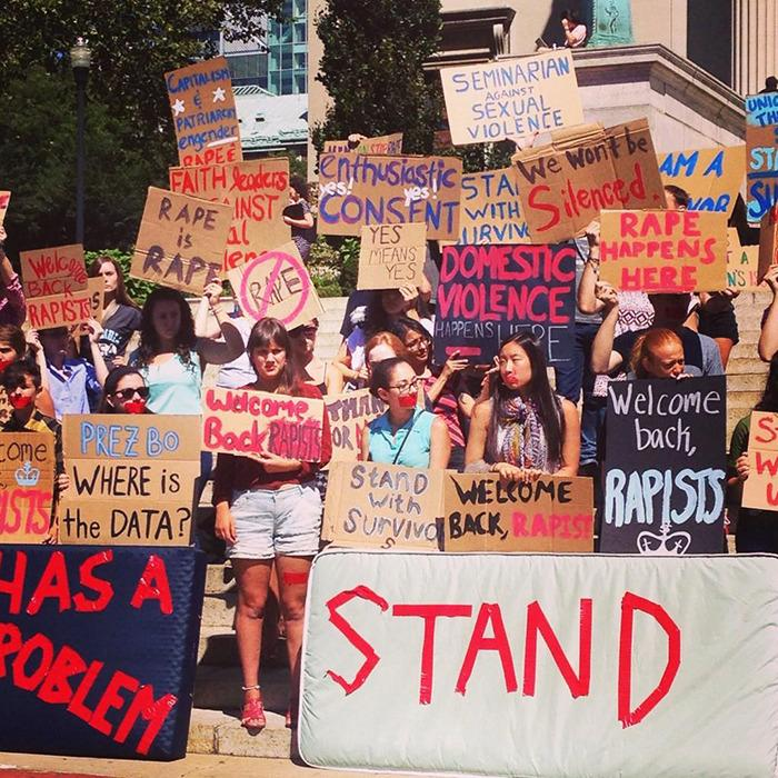 Students carry mattresses in support of Columbia student raped on campus.