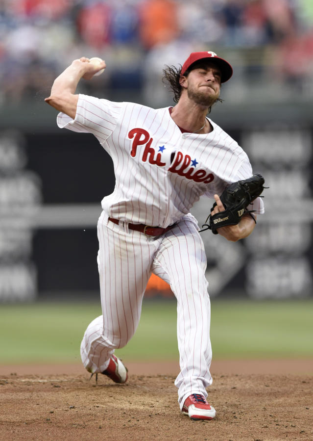 Philadelphia Phillies starting pitcher Aaron Nola throws during the first inning of a baseball game against the New York Mets, Friday, Aug. 17, 2018, in Philadelphia. (AP Photo/Michael Perez)