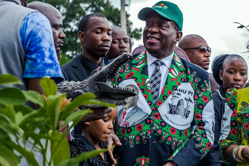 President Emmerson Mnangagwa received a statue of a crocodile -- his nickname -- after planting a tree at the party conference