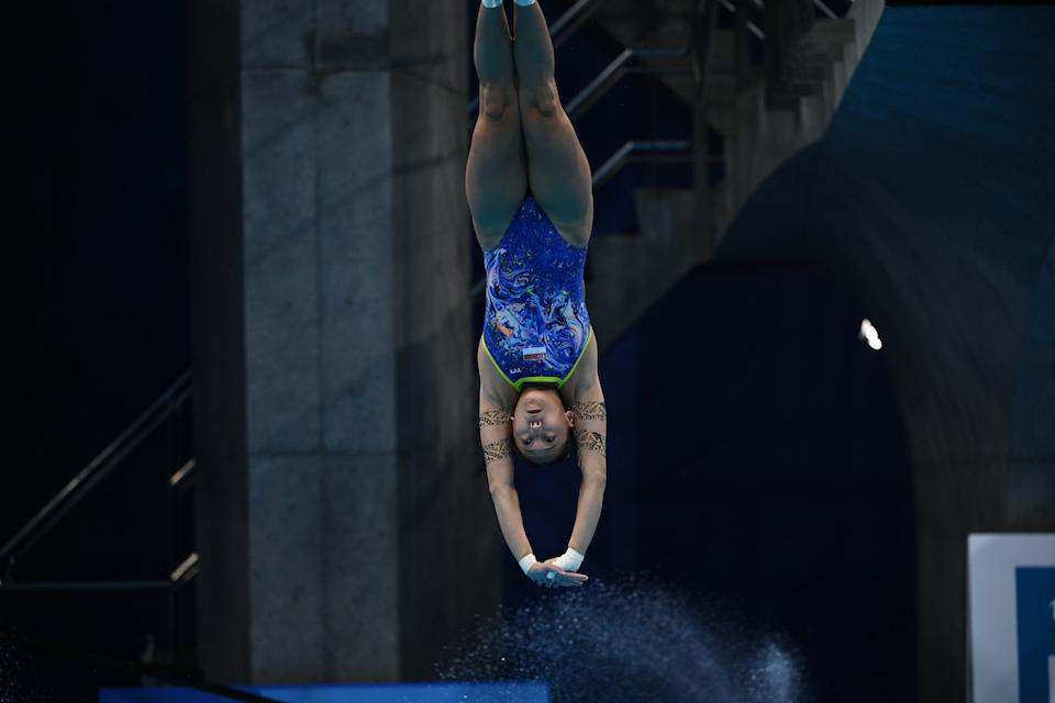 Singapore diver Freida Lim competes in the women's 10m platform preliminary round at the 2020 Tokyo Olympics. (PHOTO: Oli Scarff/AFP)