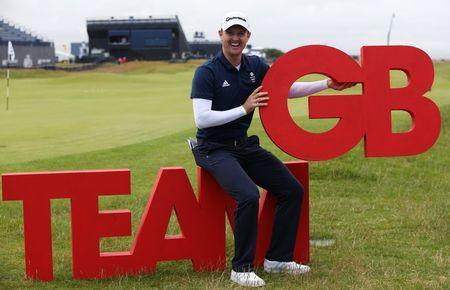 Golf-British Open - England's Justin Rose poses with the Team GB logo after being unveiled as part of Britain's Olympic Team - Royal Troon, Scotland, Britain - 13/07/2016. REUTERS/Russell Cheyne