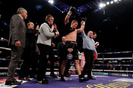 FILE PHOTO: Boxing - Alexander Povetkin vs David Price - WBA Inter-Continental & WBO International Heavyweight Titles - Principality Stadium, Cardiff, Britain - March 31, 2018 Alexander Povetkin celebrates after winning the fight as David Price looks dejected Action Images via Reuters/Andrew Couldridge