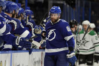 Tampa Bay Lightning defenseman Erik Cernak (81) celebrates his goal against the Dallas Stars with the bench during the third period of an NHL hockey game Wednesday, May 5, 2021, in Tampa, Fla. (AP Photo/Chris O'Meara)