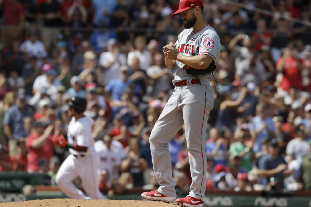 Los Angeles Angels' Patrick Sandoval, right, stands on the mound as Boston Red Sox's Christian Vazquez, left, runs the bases toward home after hitting a two-run home run in the fourth inning of a baseball game, at Fenway Park, Sunday, Aug. 11, 2019, in Boston. (AP Photo/Steven Senne)