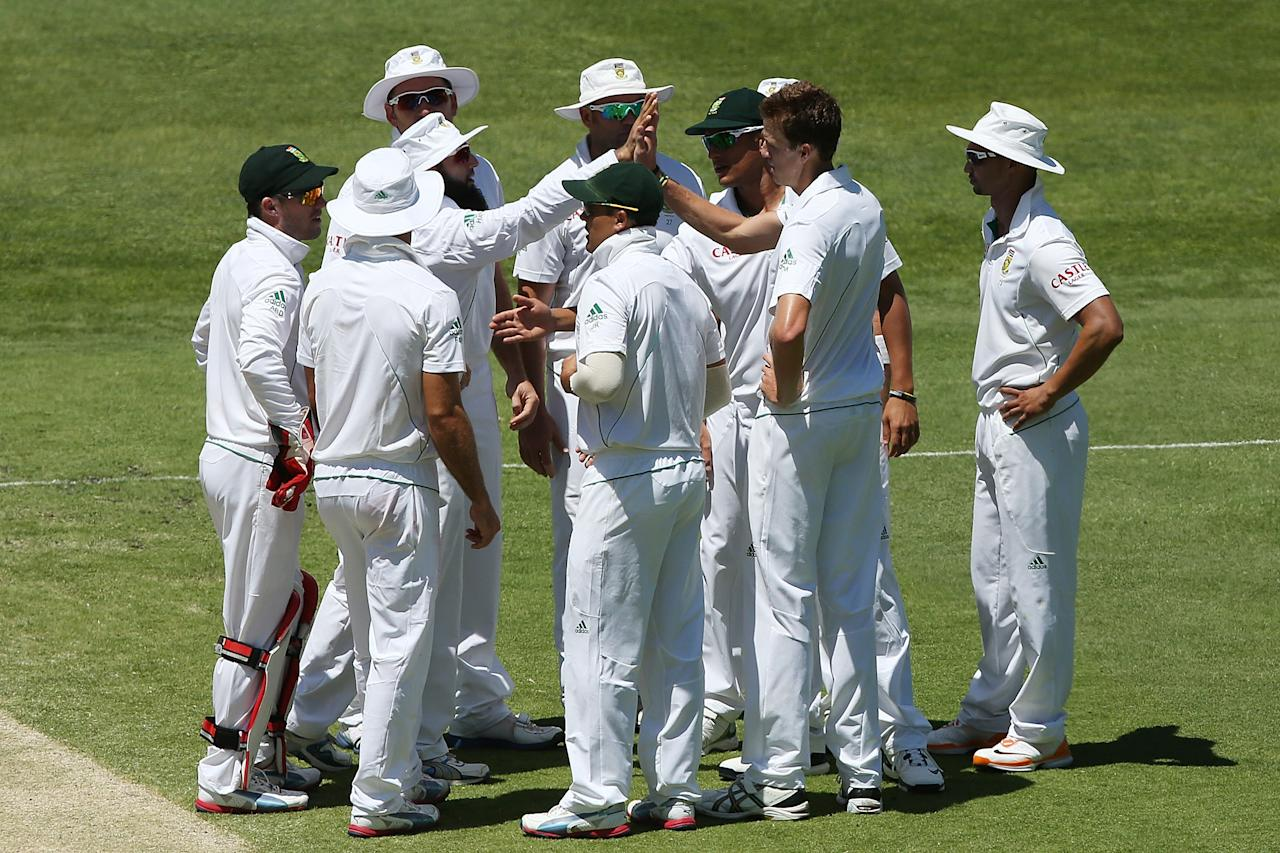 BRISBANE, AUSTRALIA - NOVEMBER 13:  Morne Morkel of South Africa celebrates with team mates after dismissing Mike Hussey of Australia during day five of the First Test match between Australia and South Africa at The Gabba on November 13, 2012 in Brisbane, Australia.  (Photo by Chris Hyde/Getty Images)