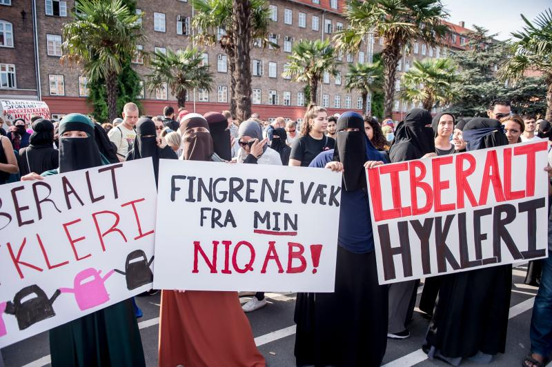 Women wearing niqab to veil their faces take part in a demonstration on Aug. 1, 2018, the first day of the implementation of the Danish face veil ban, in Copenhagen, Denmark. (MADS CLAUS RASMUSSEN via Getty Images)
