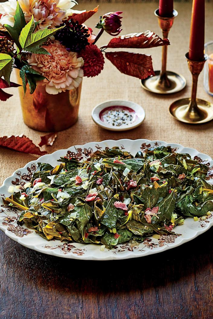 "<p><b>Recipe: </b><a href=""https://www.southernliving.com/recipes/slow-cooker-collard-greens-with-ham-hocks-recipe"" rel=""nofollow noopener"" target=""_blank"" data-ylk=""slk:Slow-Cooker Collard Greens with Ham Hocks"" class=""link rapid-noclick-resp""><b>Slow-Cooker Collard Greens with Ham Hocks</b></a></p> <p>We love any excuse to break out the slow-cooker. Start these greens in the morning and leave them to cook low and slow all day long.</p>"