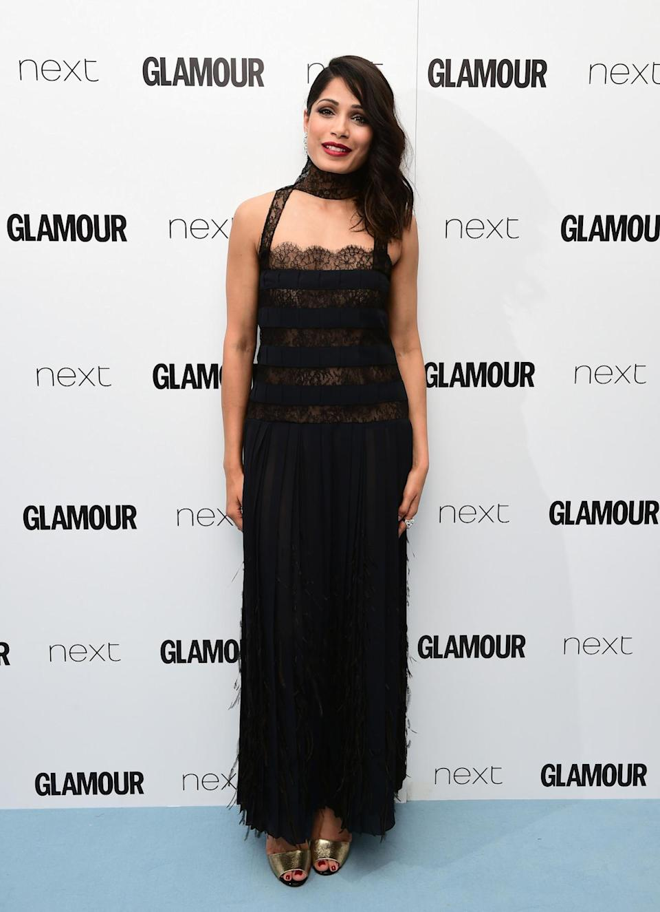"""<p>The """"Slumdog Millionaire"""" starlet also opted for a black number, but chose a tiered lace version complete with collar. <i>[Photo: PA Images]</i></p>"""