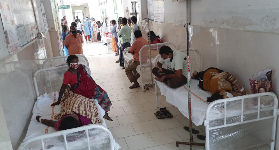 Patients and their bystanders are seen at the district government hospital in Eluru, Andhra Pradesh state, India.