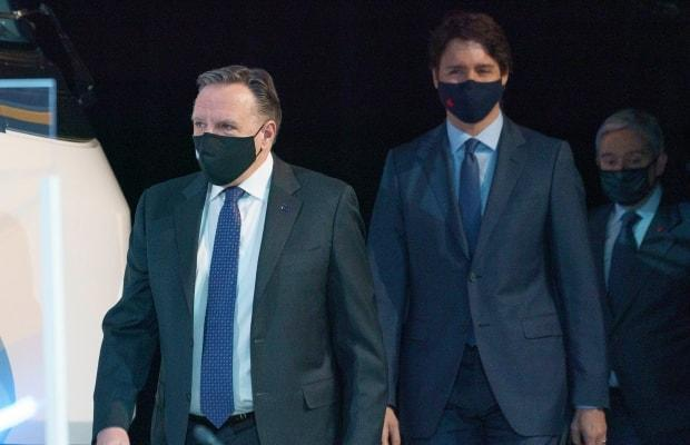 Quebec Premier Francois Legault and Prime Minister Justin Trudeau arrive at a news conference in Montreal, on Monday, March 15, 2021.  (Paul Chiasson/The Canadian Press - image credit)