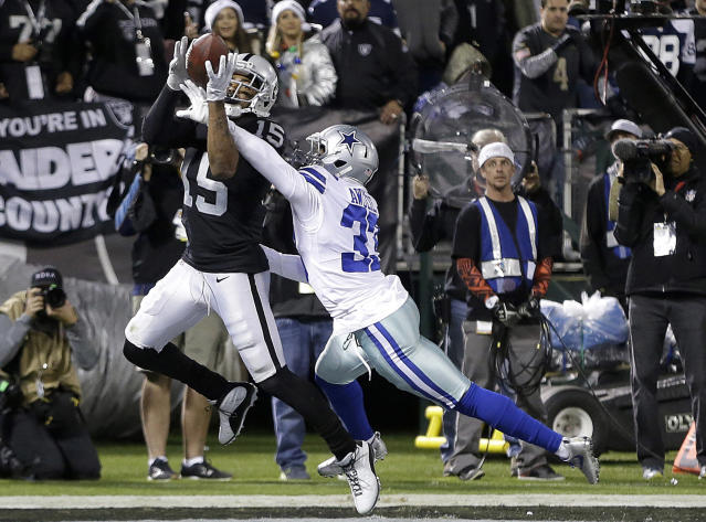 FILE - In this Dec. 17, 2017, file photo, Oakland Raiders wide receiver Michael Crabtree (15) catches a touchdown pass in front of Dallas Cowboys cornerback Chidobe Awuzie (33) during the second half of an NFL football game in Oakland, Calif. Baltimore Ravens general manager Ozzie Newsome turned his attention toward nine-year veteran Crabtree after former Washington Redskins wide receiver Ryan Grant failed his physical. Crabtree, a free agent, toured the Ravens team complex on Friday, March 16, 2018. (AP Photo/Ben Margot, File)