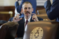 Texas State Rep. Andrew Murr, R-Kerrville, talks with fellow lawmakers as they prepare to debate voting bill SB1 in the House Chamber at the Texas Capitol, Thursday, Aug. 26, 2021, in Austin, Texas. (AP Photo/Eric Gay)