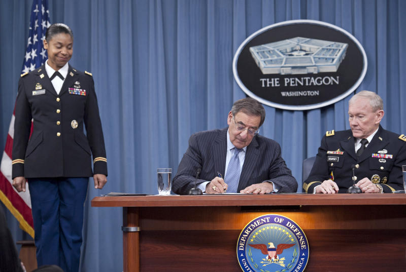 Defense Secretary Leon Panetta, with Joint Chiefs Chairman Gen. Martin Dempsey, right, and Army Lt. Col. Tamatha Patterson