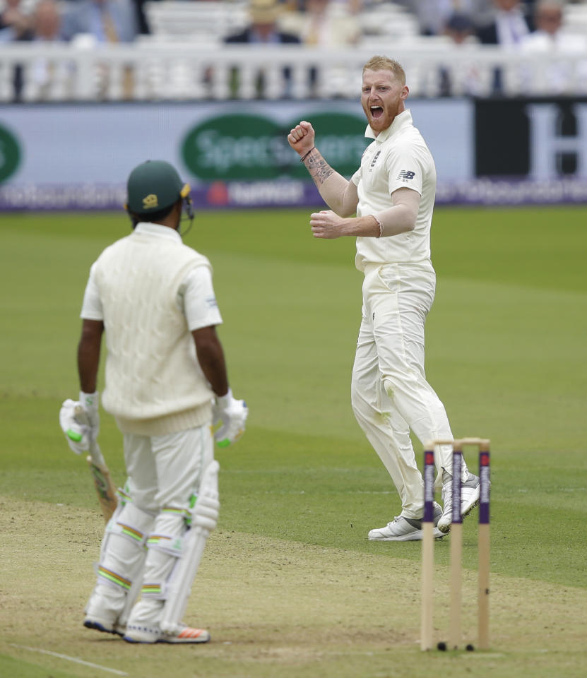 England's Ben Stokes, left celebrates taking the wicket of Pakistan's Asad Shafiq caught by England's David Malan during the second day of play of the first test cricket match between England and Pakistan at Lord's cricket ground in London, Friday, May 25, 2018. (AP Photo/Alastair Grant)
