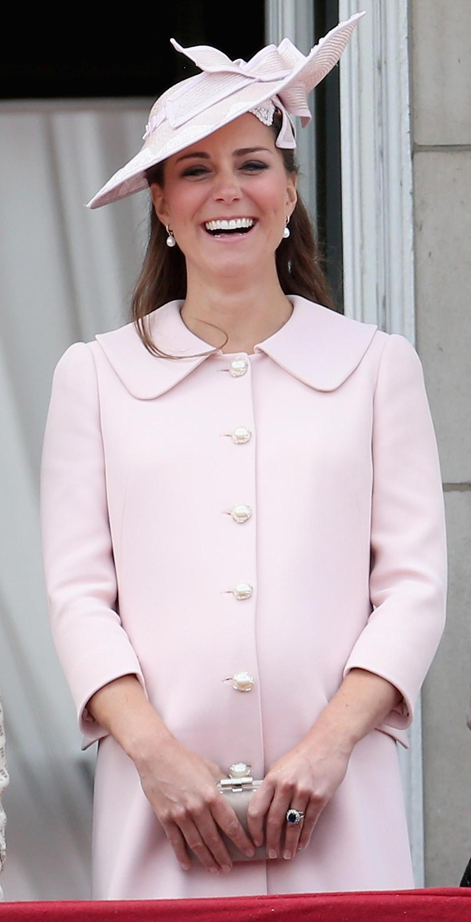 In 2013, the Duchess of Cambridge dressed her baby bump in a powder pink Alexander McQueen number finished with pearl buttons. (Rex pictures)