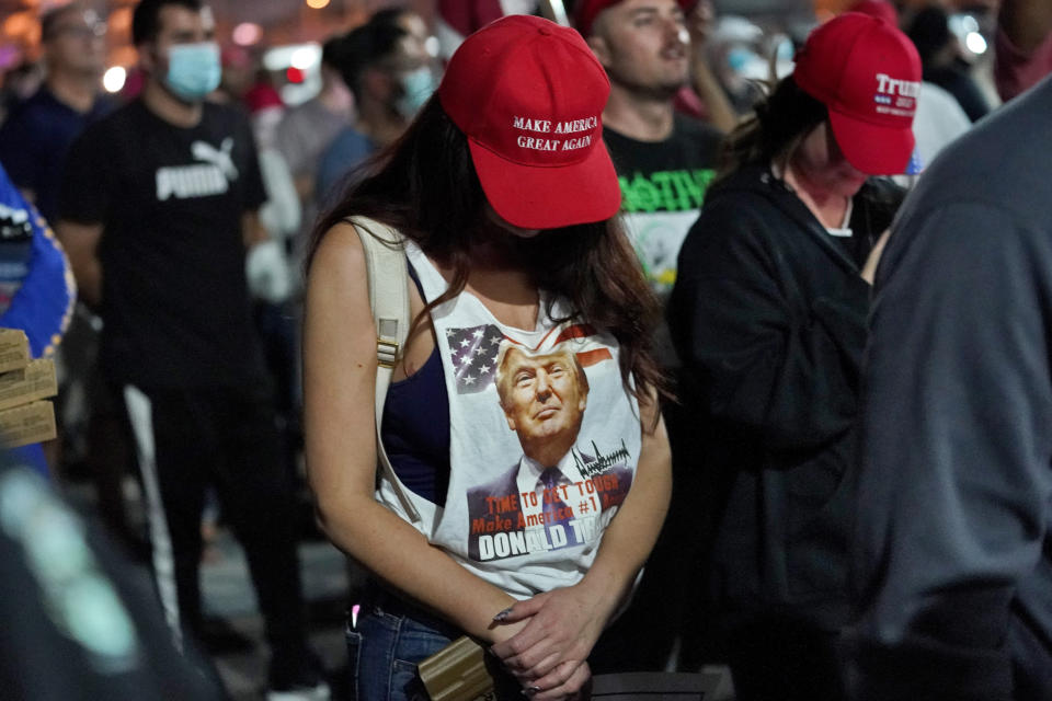 Supporters of President Donald Trump pause for prayer during a rally outside the Maricopa County Recorders Office, Wednesday, Nov. 4, 2020, in Phoenix. (AP Photo/Matt York)