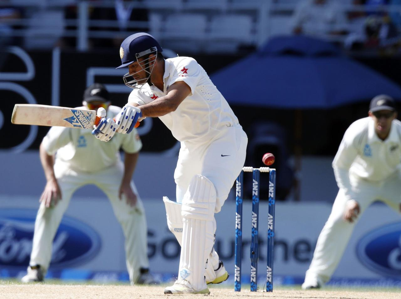 India's MS Dhoni misses the ball during his second innings on day four of the first international test cricket match against New Zealand, at Eden Park in Auckland, February 9, 2014. REUTERS/Nigel Marple (NEW ZEALAND - Tags: SPORT CRICKET)