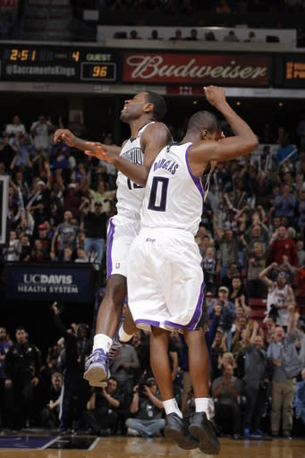 SACRAMENTO, CA - MARCH 19: Tyreke Evans #13 and Toney Douglas #0 celebrate after the play against the Los Angeles Clippers on March 19, 2013 at Sleep Train Arena in Sacramento, California. (Photo by Rocky Widner/NBAE via Getty Images)