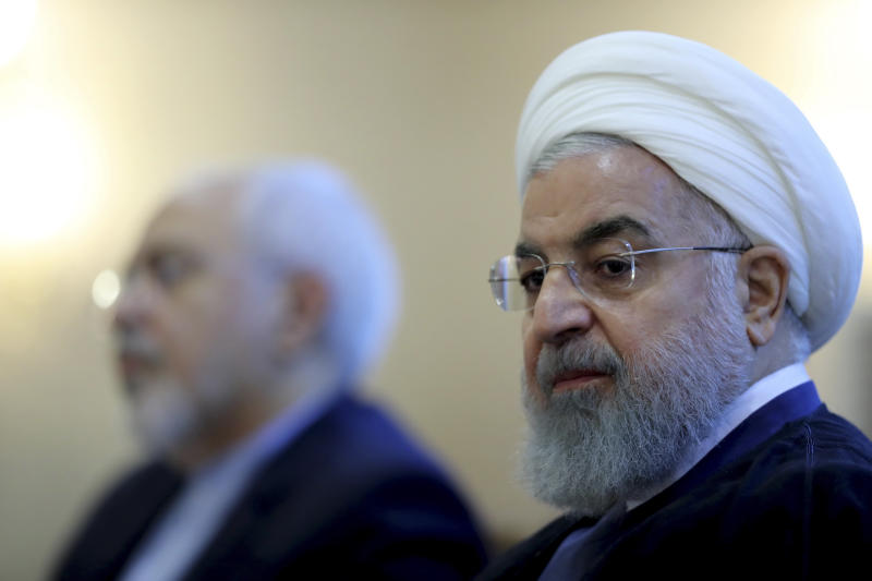 In this photo released by official website of the office of the Iranian Presidency, President Hassan Rouhani attends a meeting with a group of foreign ministry officials in Tehran, Iran, Sunday, July 22, 2018. Rouhani warned President Donald Trump against provoking his country while indicating peace between the two nations might still be possible. (Iranian Presidency Office via AP)