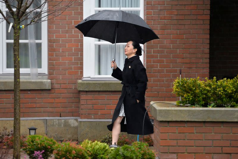 FILE PHOTO: Huawei Chief Financial Officer Meng Wanzhou leaves her home to attend her extradition hearing in Vancouver