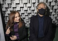 Isabelle Huppert, left, and Paul McCartney attend the Stella McCartney Spring-Summer 2022 ready-to-wear fashion show presented in Paris, Monday, Oct. 4, 2021. (Photo by Vianney Le Caer/Invision/AP)