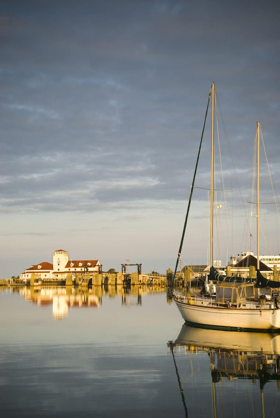 """<p>This slim island in North Carolina's Outer Banks is home to just under 1,000 people. Only accessible by boat or plane, much of the island is the undeveloped <a href=""""https://www.outerbanks.com/cape-hatteras-national-seashore.html"""" rel=""""nofollow noopener"""" target=""""_blank"""" data-ylk=""""slk:Cape Hatteras National Seashore"""" class=""""link rapid-noclick-resp"""">Cape Hatteras National Seashore</a>, where you can find <a href=""""https://www.outerbanks.com/ocracoke.html"""" rel=""""nofollow noopener"""" target=""""_blank"""" data-ylk=""""slk:wild ponies"""" class=""""link rapid-noclick-resp"""">wild ponies</a> (believed to be descendants of Spanish Mustangs) roaming. You can explore the island on foot, bike, or horseback, then head back to the village for a meal at a laid-back waterfront restaurant. Since the population is so small, it's kind of like Cheers: Everyone knows your name.</p>"""