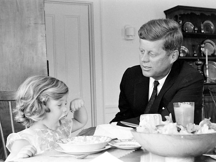 John F. Kennedy with his daughter Caroline in 1960.
